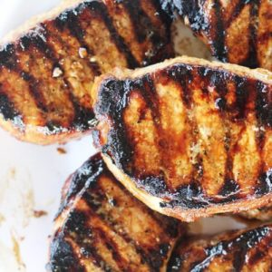 Grilled, juicy pork chops on a platter