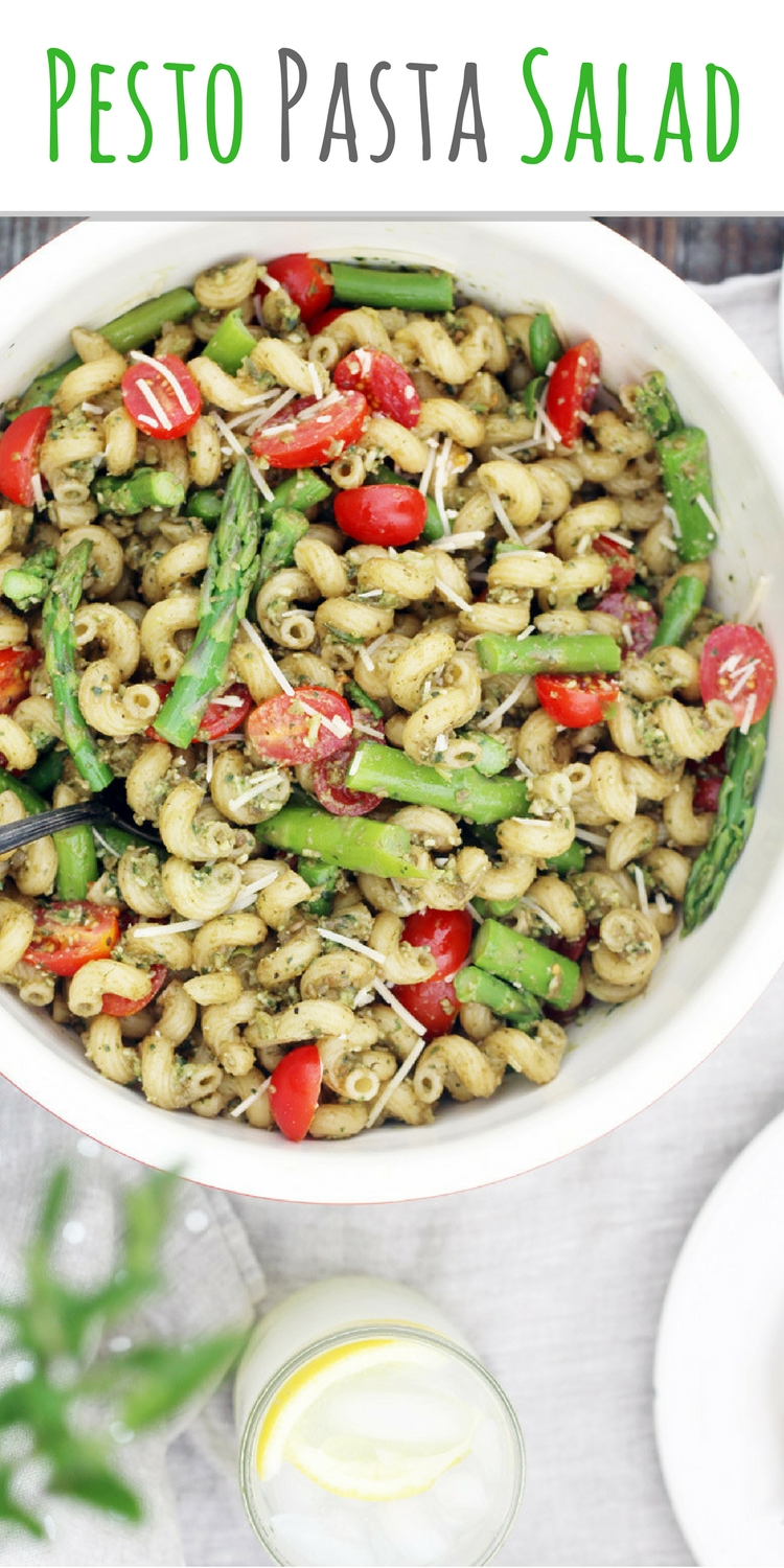 Perfect for picnics, parties, and potlucks, this Fresh Basil Pesto Pasta Salad is big on flavor. Tossed with a homemade pesto sauce made from basil and sunflower seeds, every swirled piece of pasta is coated with the unmistakable flavor of basil. We added brightly sweet tomatoes and asparagus for even more fresh flavor.  #pestopastasalad #pastasaladrecipe