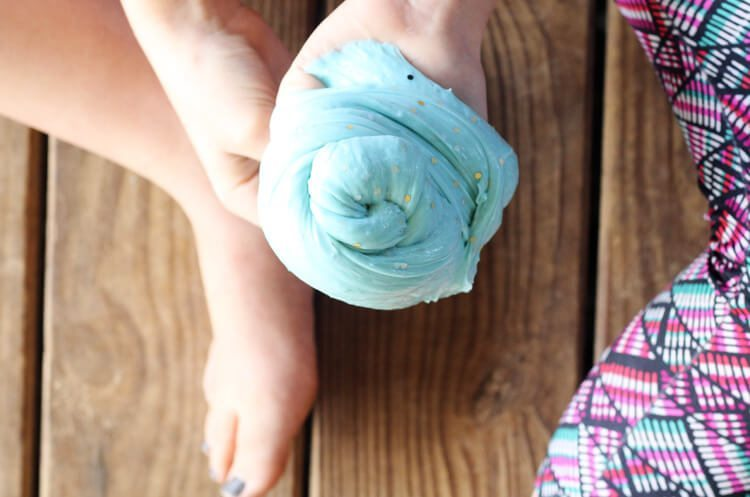 A turquoise blue knot of homemade stretchy slime