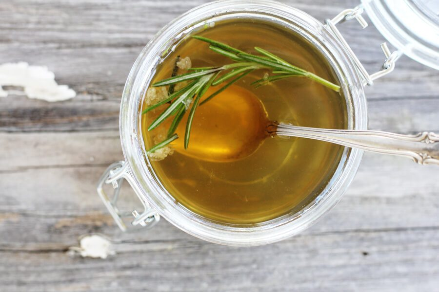 A small jar of rosemary infused honey syrup