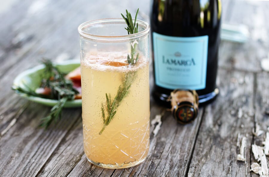 A bubbly glass of grapefruit + rosemary prosecco cocktail