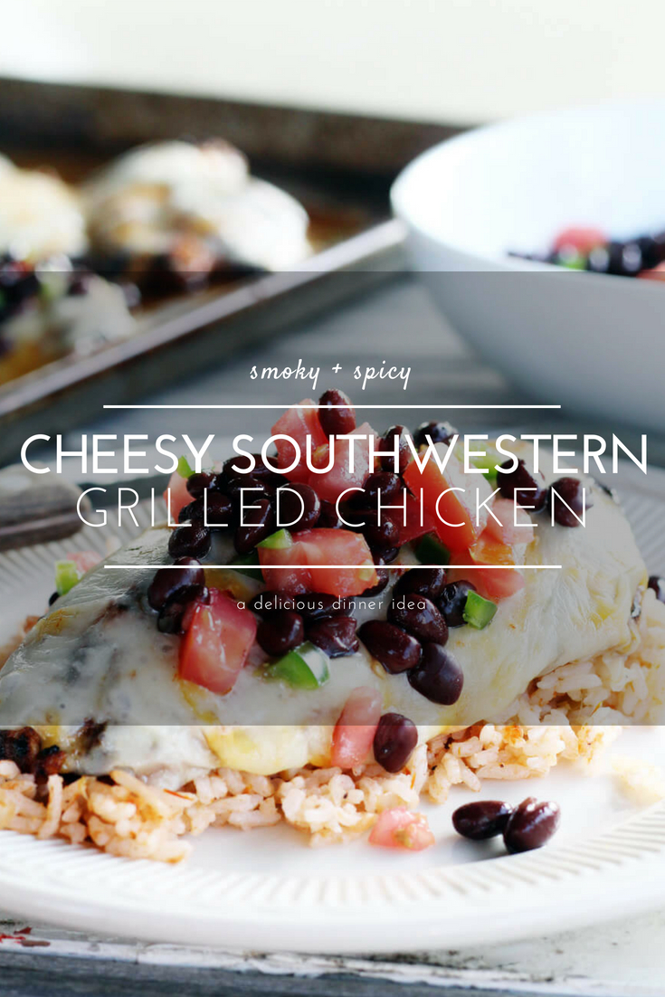 Get ready to dig into this smoky and savory recipe for Cheesy Southwestern Grilled Chicken. Fire up the grill and fire up the flavor this summer. This recipe features tender spiced chicken topped with ooey-gooey-melty cheese and a fast + fresh black bean salsa. #grilledchicken #southwesternchicken