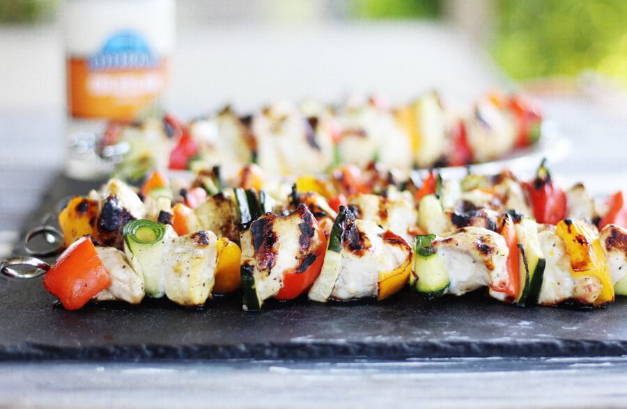 Grilled chicken skewers on a slate board