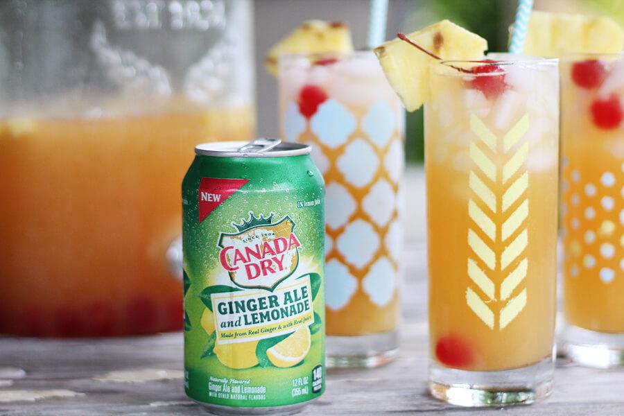Canada Dry Ginger Ale Lemonade next to tropical lemonade mocktail in stenciled glasses