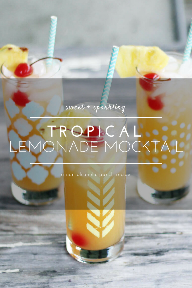 There's nothing more delicious in the summer than a cold + refreshing drink in hand. This Tropical Lemonade Mocktail recipe is sparkling, sweet and just the perfect amount of tart. Made with ginger ale lemonade, pineapple juice, mango nectar and fresh fruit, this is an easy mocktail punch recipe you are going to love.  #mocktail #tropicallemonade