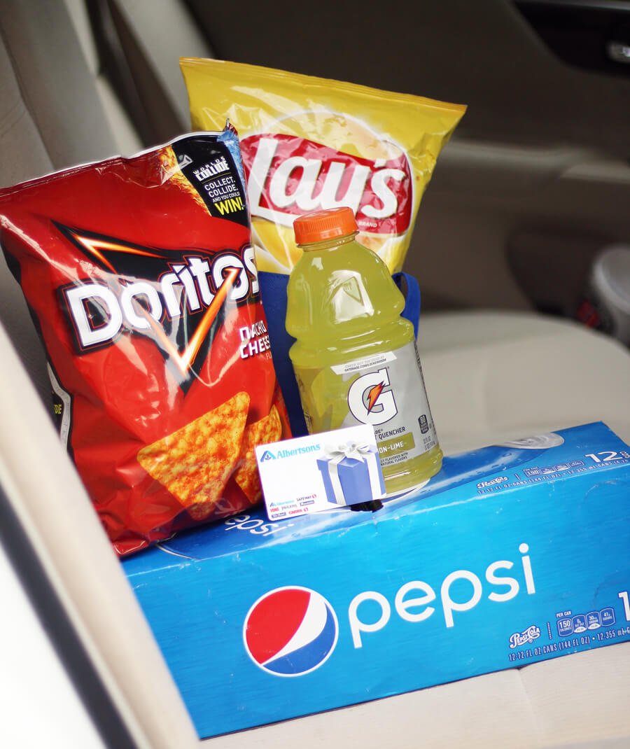 Chips and drinks ready to ride on this summer road trip