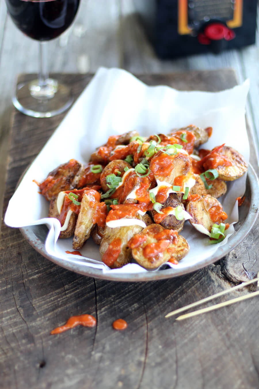 Patatas Bravas is an addictive appetizer that starts with crisp oven-roasted potatoes and is topped with a to-die-for homemade garlic tomato sauce. Every bite is a mouthful of nom nom flavor, and you'll be begging for more.