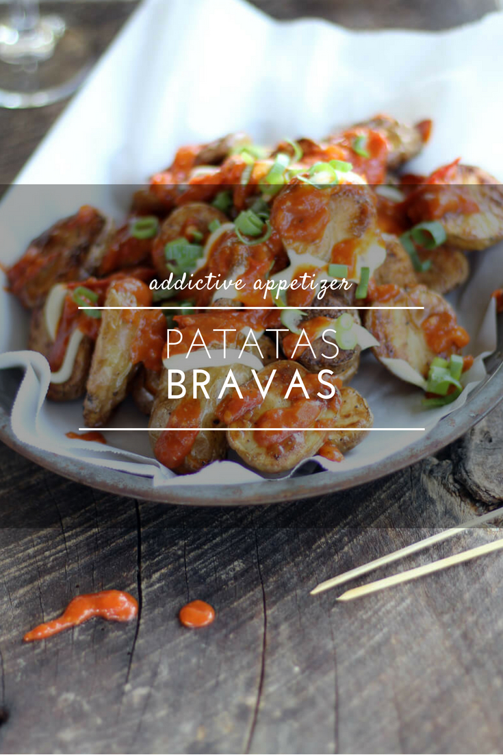 Patatas Bravas is an addictive appetizer that starts with crisp oven-roasted potatoes and is topped with a to-die-for homemade garlic tomato sauce.Every bite is a mouthful of nom nom flavor, and you'll be begging for more. #patatasbravas #appetizer