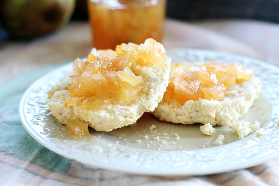Sweet citrus and ginger pear preserves on a buttery biscuit