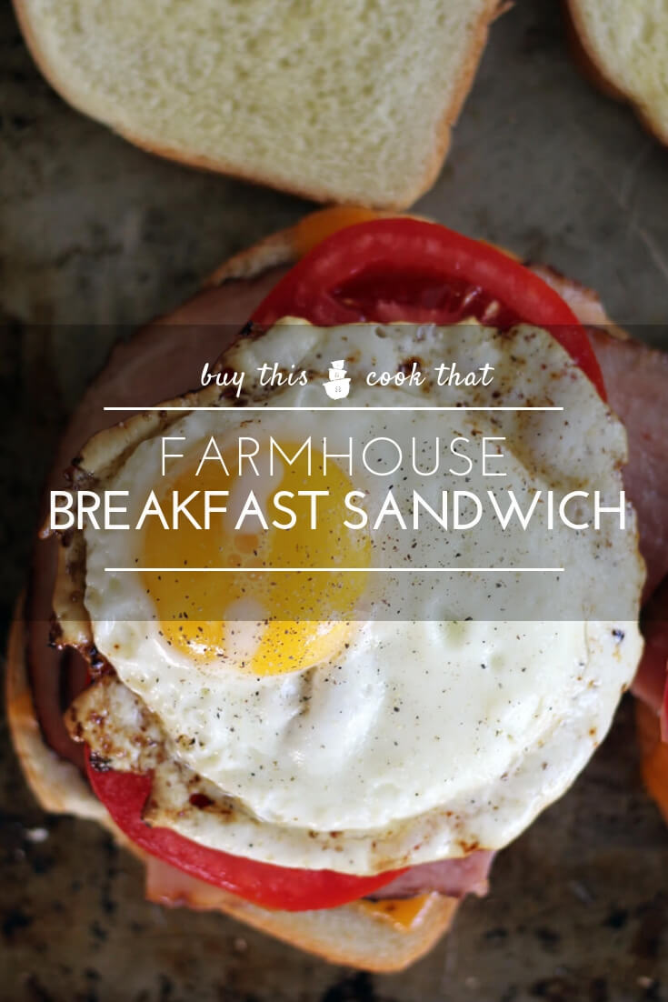 Farmhouse Breakfast Sandwich | Buy This Cook ThatHearty and wholesome, a Farmhouse Breakfast Sandwich is a tasty start to your morning. Golden-toasted bread, savory ham, juicy tomato, cheddar and a fried egg.  #breakfast #breakfastsandwich