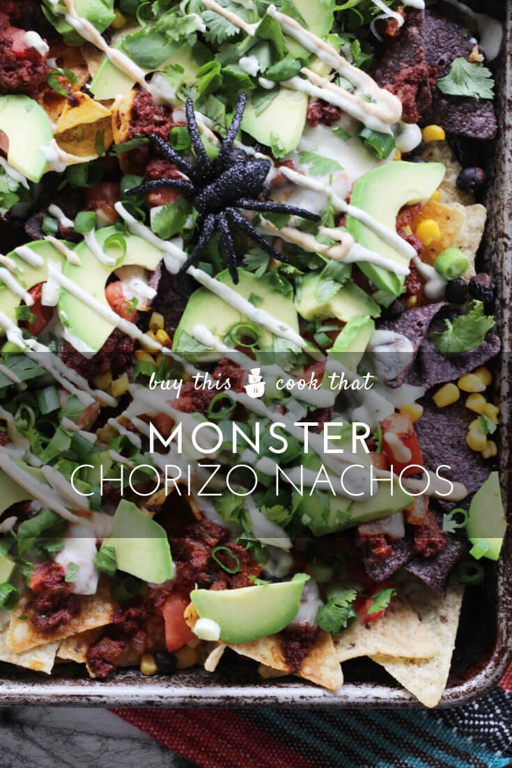 Monster Chorizo Nachos Recipe | Buy This Cook ThatThis Monster Chorizo Nachos Recipe is a party platter that no monster can resist. Loaded with spicy chorizo, Oaxaca cheese, black beans, avocado, cilantro and crema, these nachos are snackable + shareable.  #nachos #nachosrecipe #Halloweenrecipe #Halloweenappetizer