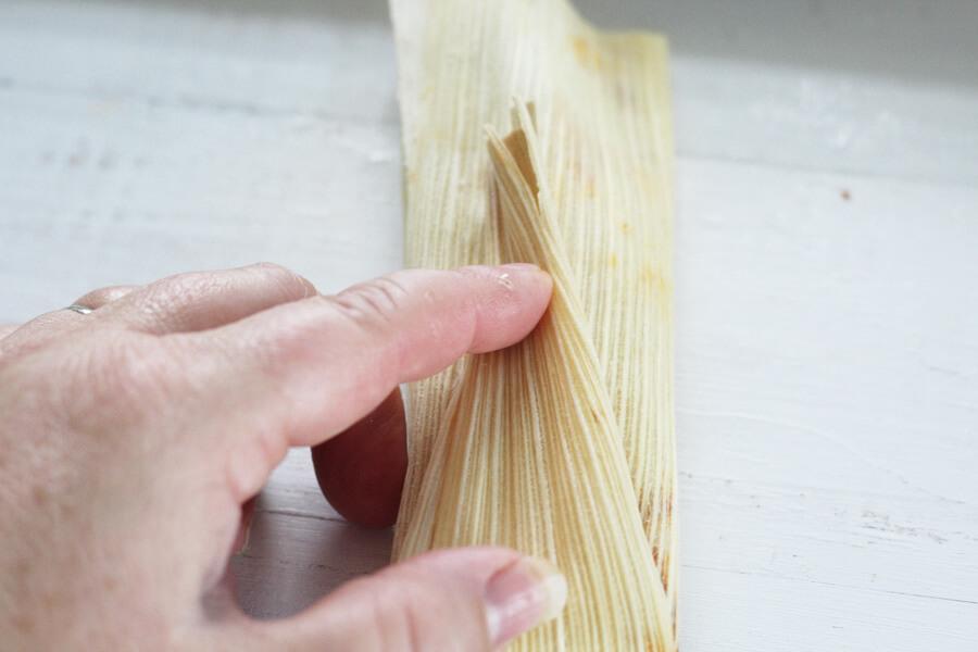 Folding a tamale