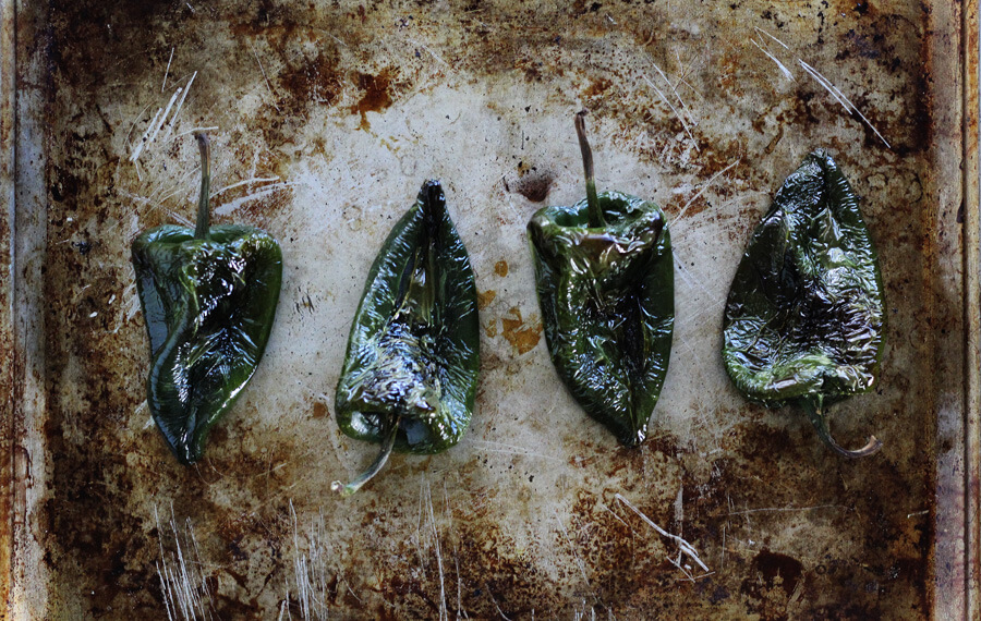 Roasted poblano peppers are an earthy slightly spicy pepper that is perfect for this tamales recipe.