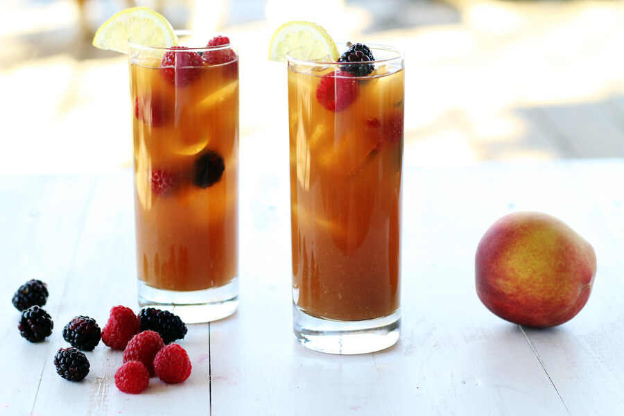 Two glasses of tea with fruit