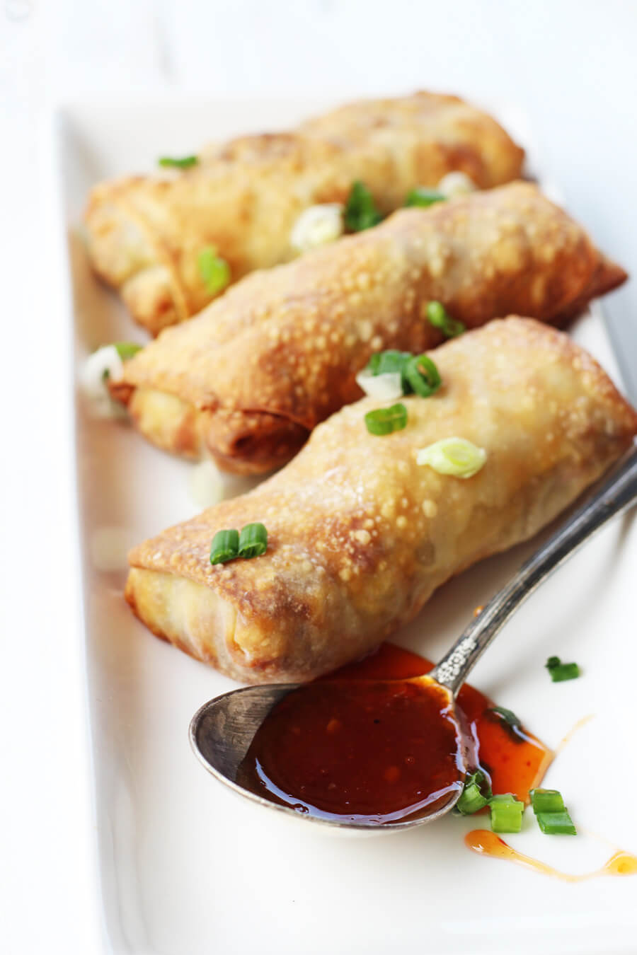 Crisp Asian-inspired egg rolls with savory pork and tender cabbage on the inside....made with our air fryer. #eggrolls #airfryer