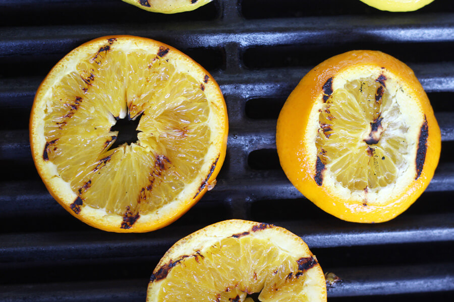 Orange and lemon slices on a hot grill