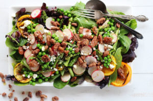 This healthy Grilled Citrus Spring Salad is loaded with seasonal asparagus, sliced radishes, and peas. Plus extra flavor from feta cheese and glazed pecans.