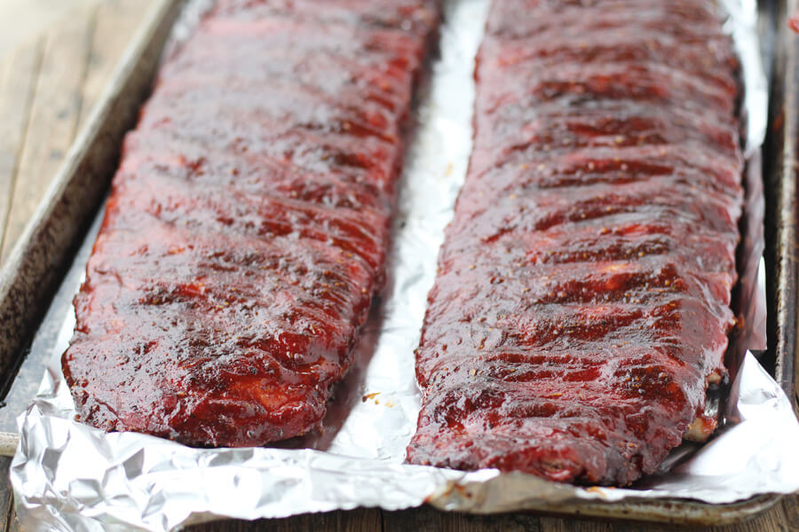 Slow roasted with charcoal, this rib recipe features a homemade spice rub and sauce.