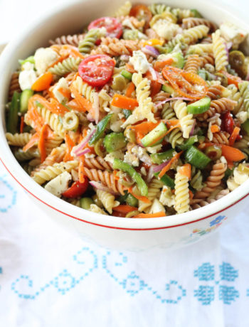 et your new favorite Italian Pasta Salad recipe. Seriously, this is the recipe that my family asks me to make for all of our gatherings. Loaded with colorful veggies and tri-color pasta, this side dish is easy to make ahead. My kids can't stop eating it, either. The best part is how easy it is to make with a few basic tips. And our not-so-secret ingredient. :)