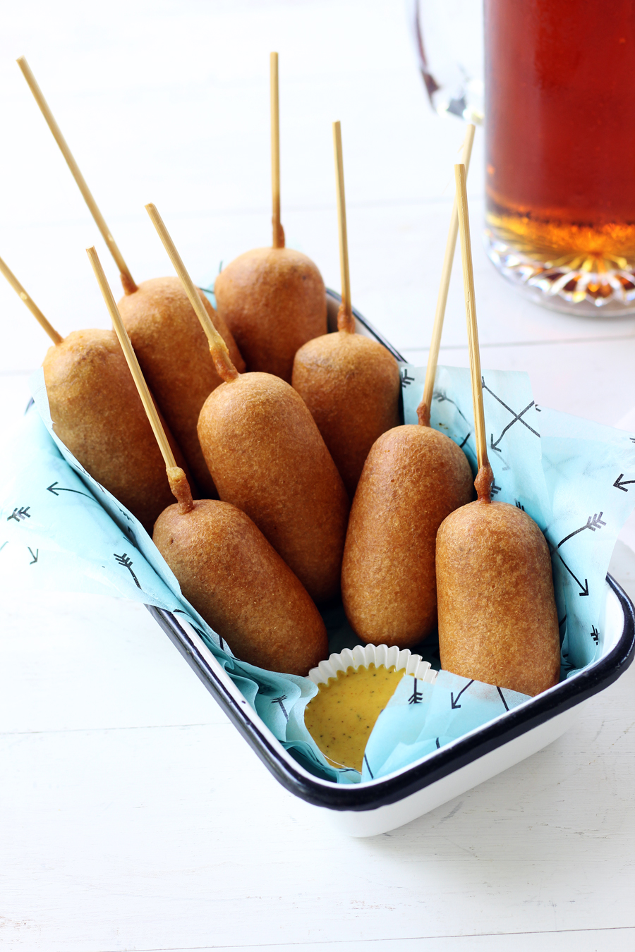 Indulge your summer food cravings with these delicious Beer Battered Bratwurst Corn Dogs!  This recipe features savory bratwurst sausages dipped in a golden, homemade beer batter then deep-fried to perfection.  #corndogs #bratwurst