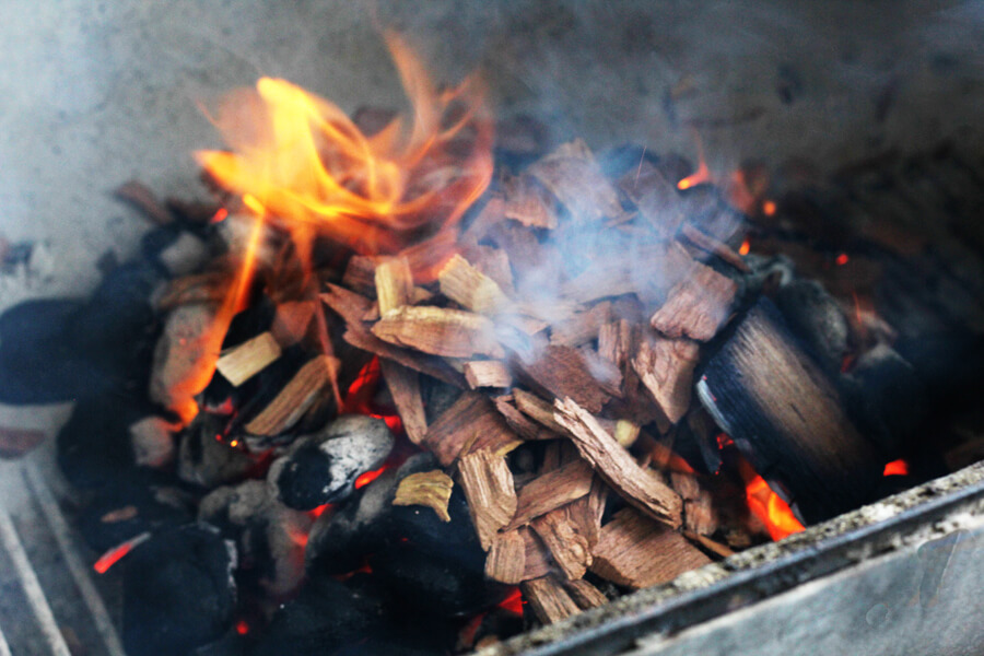Wood chips on a charcoal fire