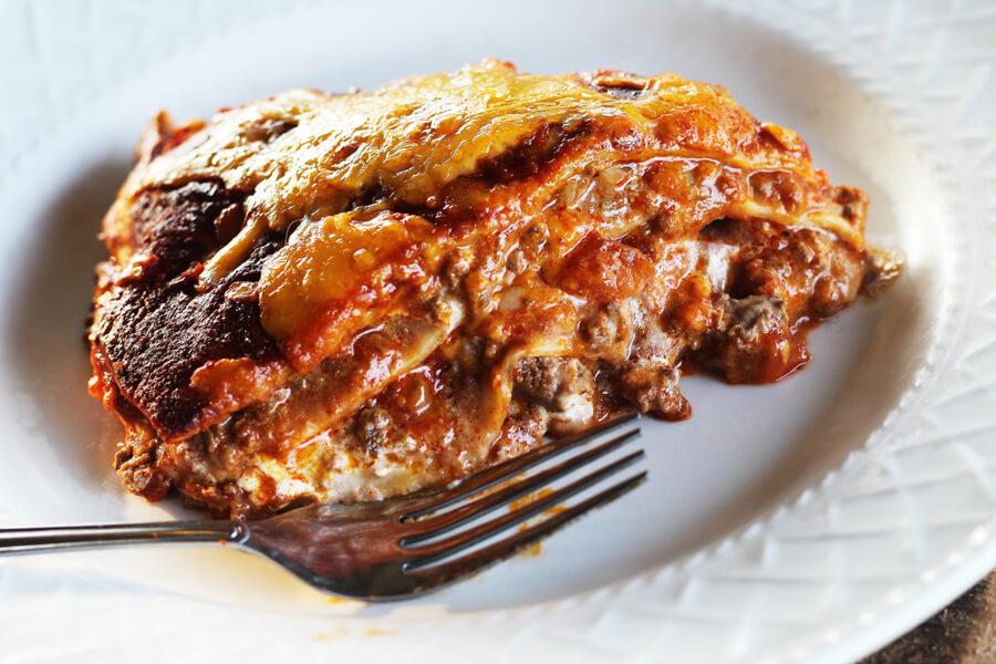 A serving of saucy enchiladas.