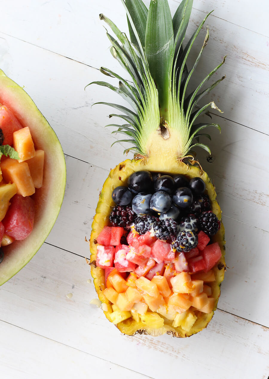 A pineapple filled with fresh fruit salad and honey yogurt dressing. #fruitsalad