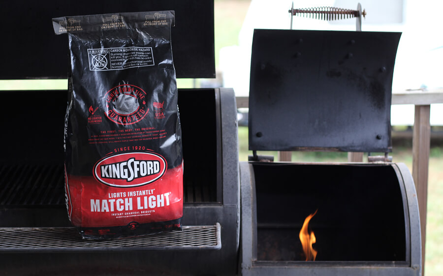 Kingsford charcoal next to a grill