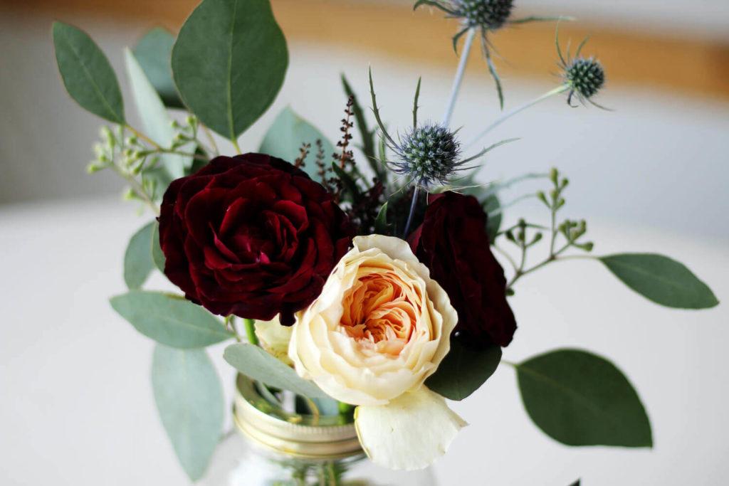 A simple, rustic wedding table arrangement.