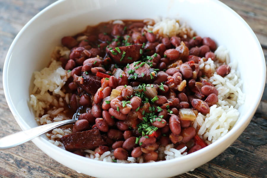 a white bowl with beans and rice
